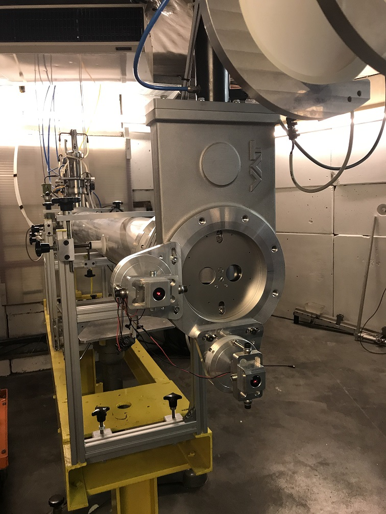 Proton beam line facing samples with the degraders in between to lower the beam energy and the dosimetry system.